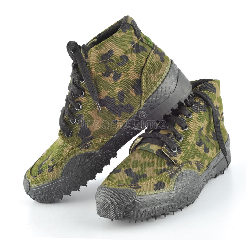 Camouflage shoes. A pair of camouflage baseball boots against white background royalty free stock image