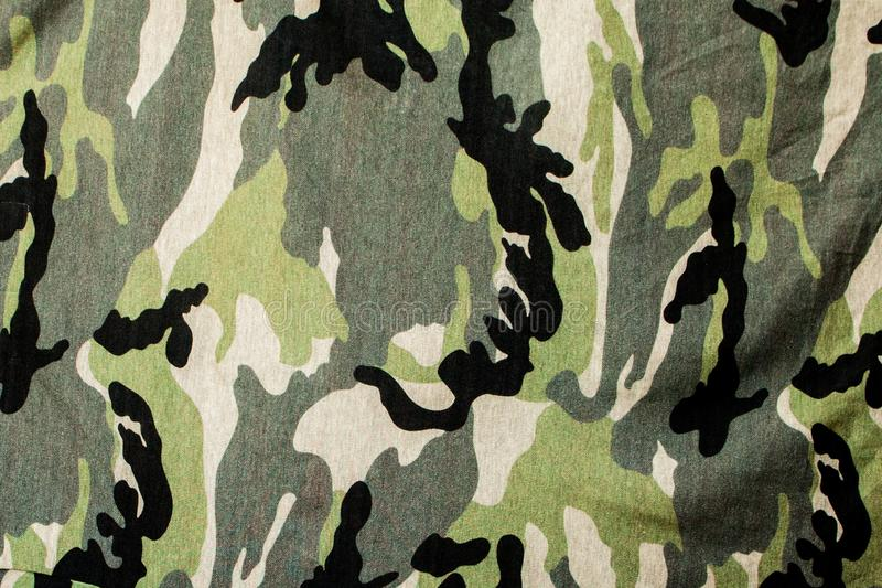 Camouflage textile cloth texture. Abstract background and texture for design stock image
