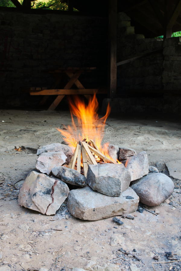 Campfire. Camp fire in fron of a cabin near a river stock photos