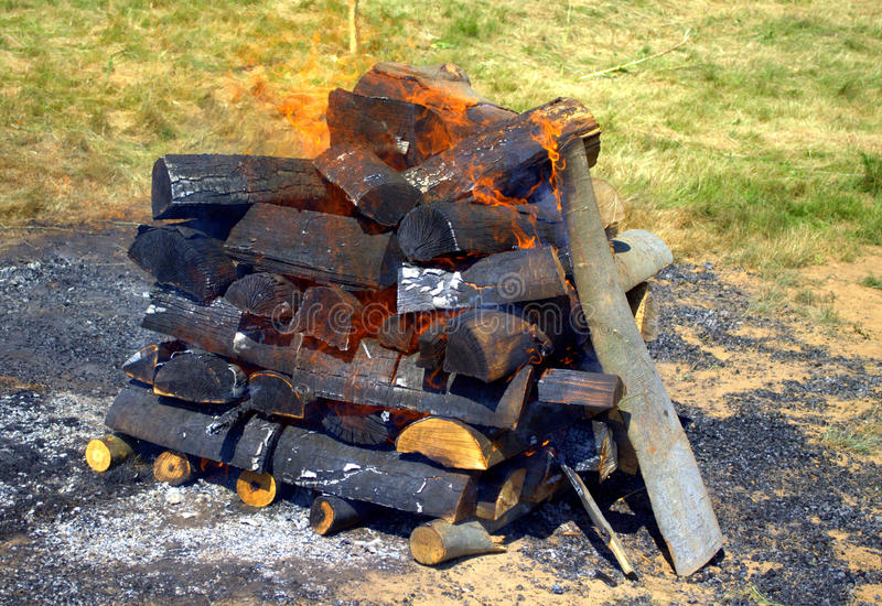 Camp fire. Getting ready to bbq royalty free stock photo