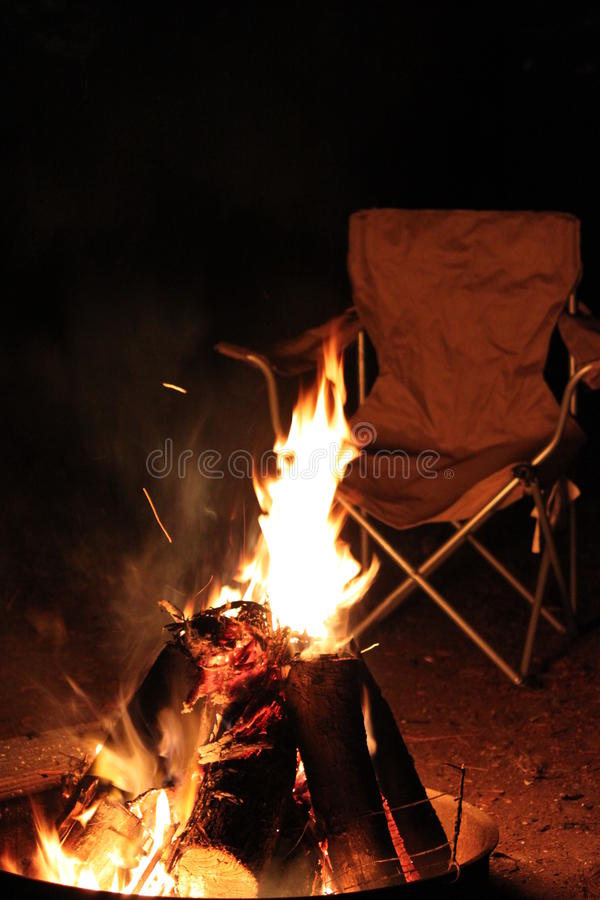 Camp fire at night stock photography