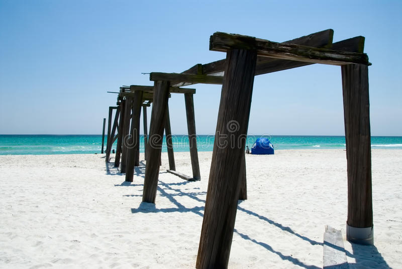 Camp Helen State Park Pier in Panama City Beach Florida Closeup. Camp Helen State Park pier in Panama City Beach Florida. There is a beach tent set up in the stock image