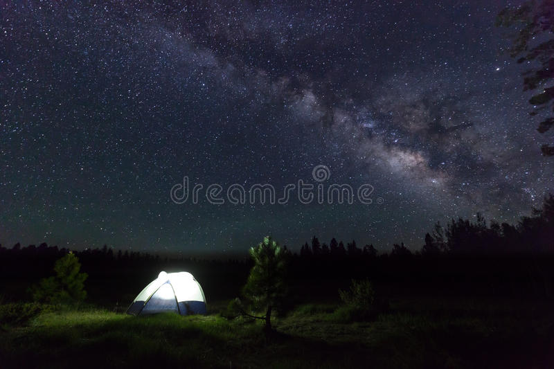 Camp Under the Stars. A forest camp lit up under the milky way in northern Arizona royalty free stock photos