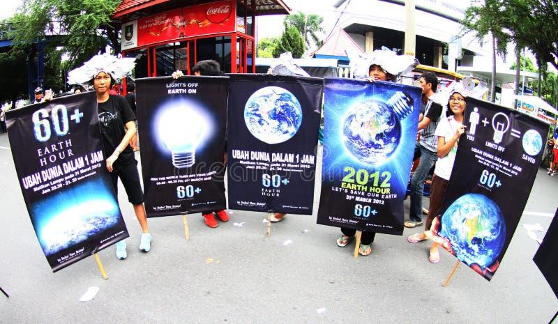 Campaña de la hora de la tierra en Indonesia fotos de archivo libres de regalías