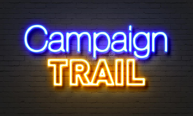 Campaign trail neon sign on brick wall background. Campaign trail neon sign on brick wall background stock photography