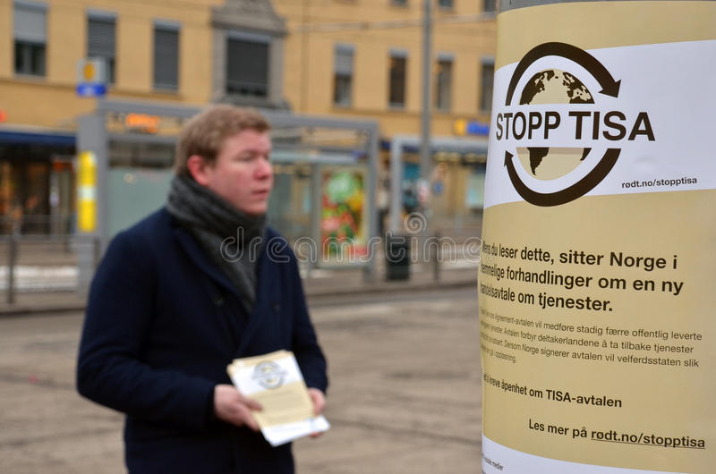 Campaigning against the Trade in Services Agreement (TISA). A young man handing out leaflets against the Trade in Services Agreement (TISA) in central Oslo. The stock photos
