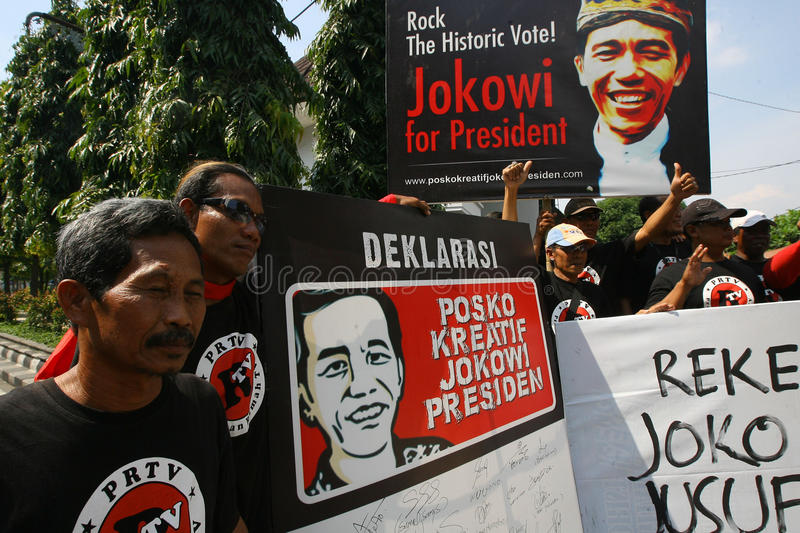 Campaigning for president cadindate. People campaigning for Indonesia presidential candidate Joko Widodo in Solo, Central Java, Indonesia stock photos