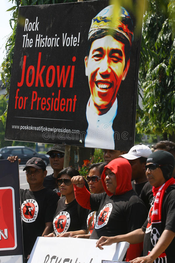 Campaigning for president cadindate. People campaigning for Indonesia presidential candidate Joko Widodo in Solo, Central Java, Indonesia royalty free stock photo
