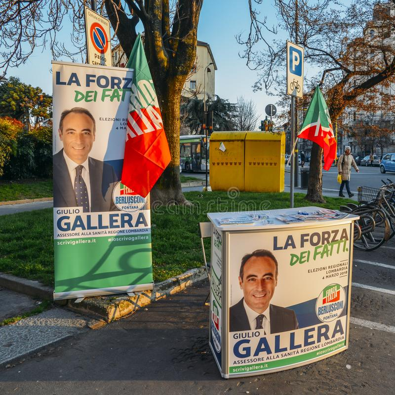Campaigning on street of Milan, Italy for Giulio Gallera of Berlusconi`s Forza Italia Party ahead of 2018 Italian general electio. Milan, Italy - Feb 13, 2018 stock photography