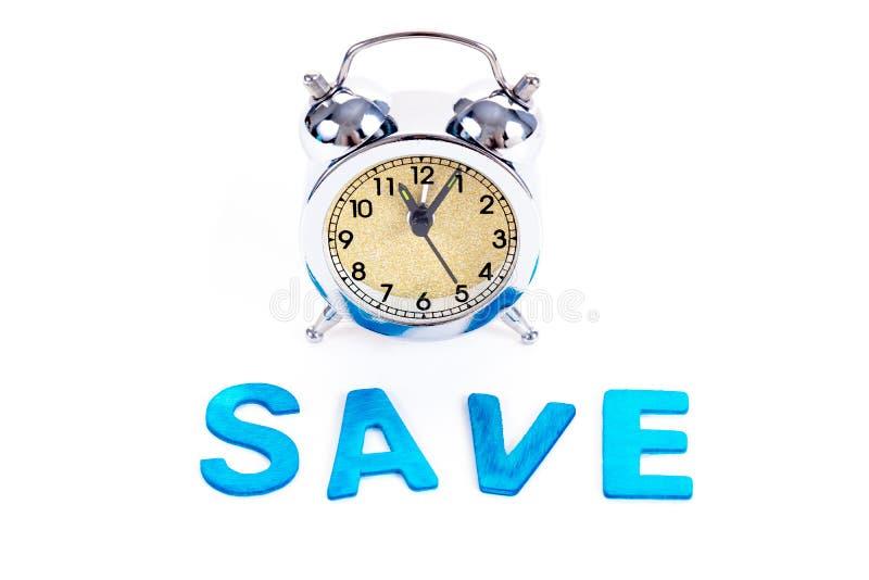 Campana del despertador del vintage con palabra de ahorro en el fondo blanco Hora de invertir, optimización de recursos del tiemp fotografía de archivo libre de regalías