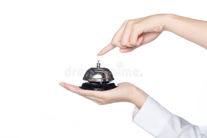 Campana e pulsante di servizio della tenuta della mano della donna fotografia stock