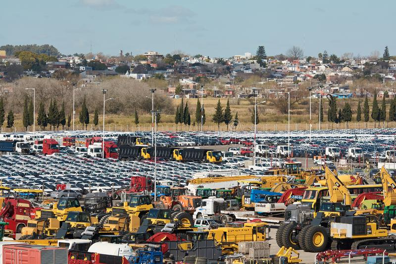 Campana River, Zarate, Argentina - 22 August 2018: Plenty of different wheel cars waiting loading on Ro-Ro vessel in a port. stock photos