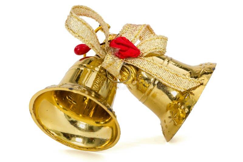 Campanas de la Navidad de oro, aisladas en el fondo blanco imagenes de archivo