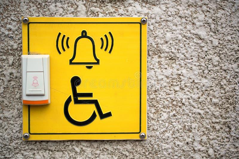 Campanello per l'entrata disabile fotografia stock