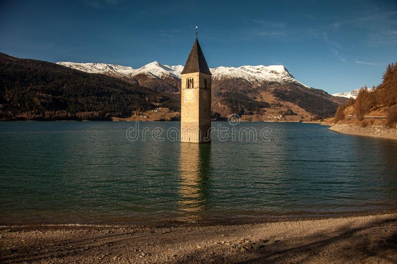 Campanile di Curon Venosta, or the bell tower of Alt-Graun, Italy. royalty free stock photography
