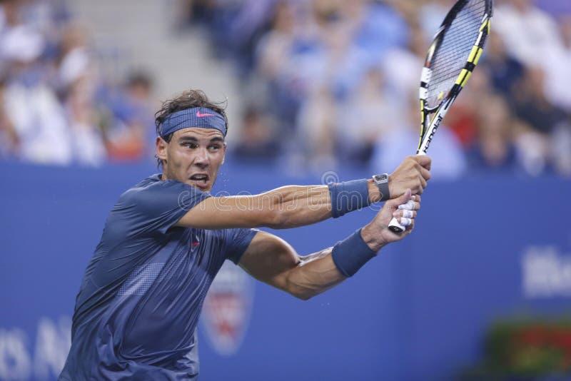 Campeão Rafael Nadal do grand slam de doze vezes durante o quarto fósforo do círculo no US Open 2013 fotografia de stock