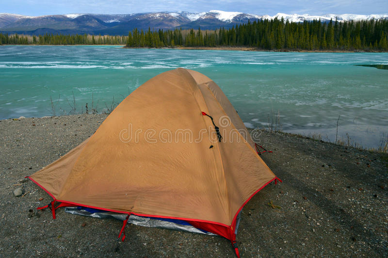 Camped on a Frozen Lake. Camping on the edge of frozen Boya Lake in northern British Columbia, Canada stock photography