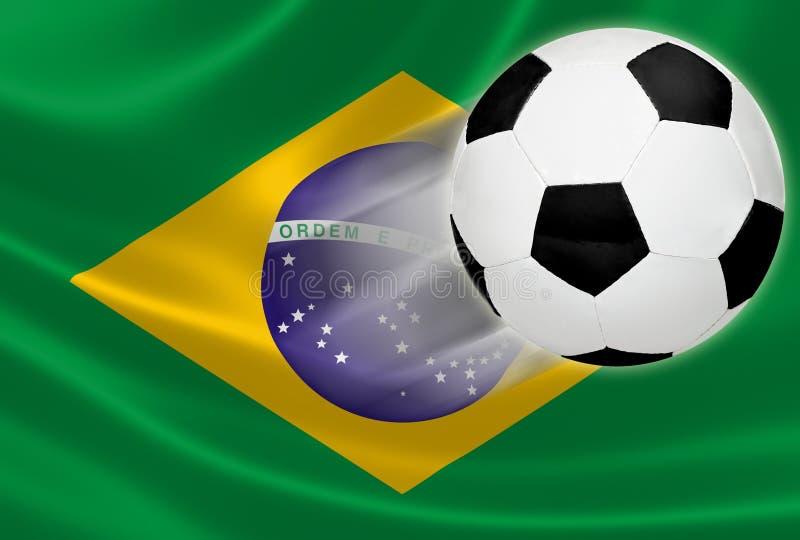 Campeonato do mundo 2014: Bola de futebol na bandeira brasileira fotografia de stock royalty free