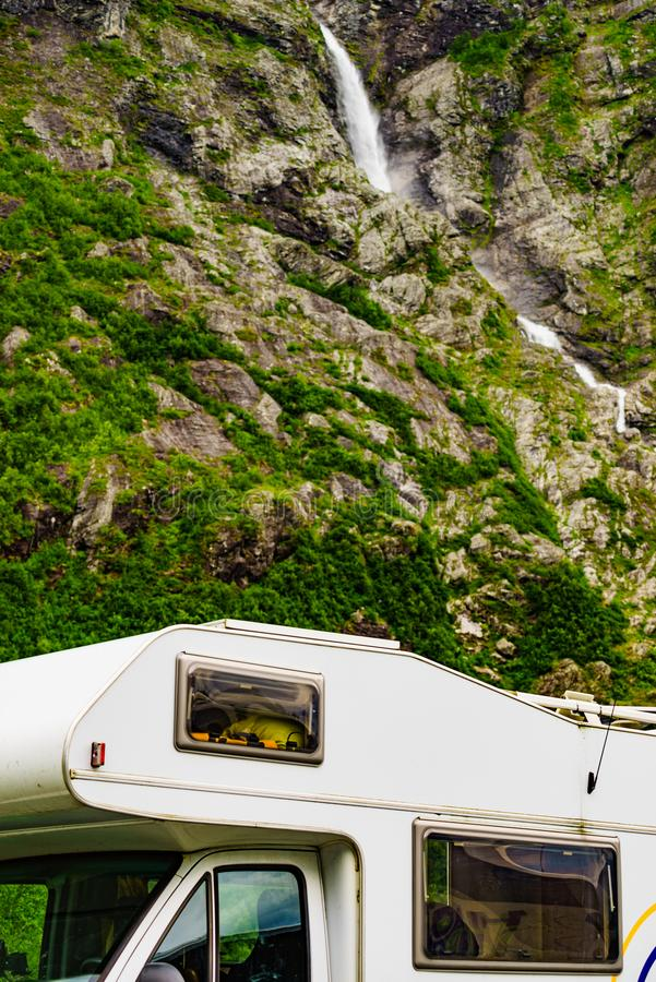 Camper car alcove in mountains. Camper car motorhome with alcove on roadside in mountains. Camping on trip. Norway Scandinavia Europe stock photo