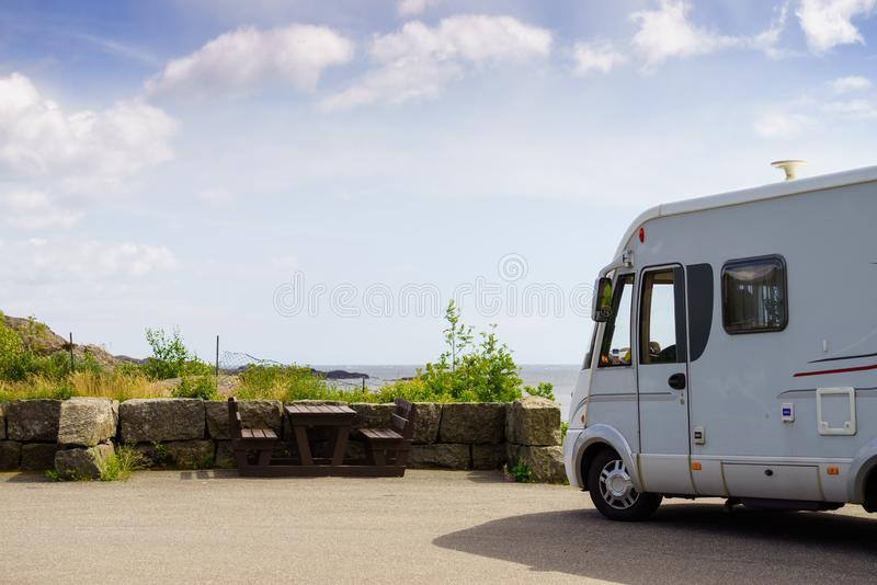 Camper car on coast of Norway with ocean view. Tourism vacation and travel. Camper van and rocky coast landscape of southern Norway with an ocean view in royalty free stock photography