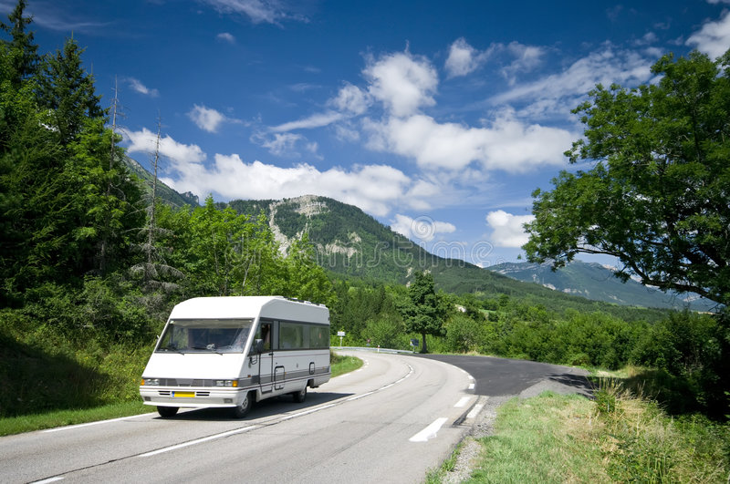 Camper in France. A white camper on a scenic road of Alpine France royalty free stock photos