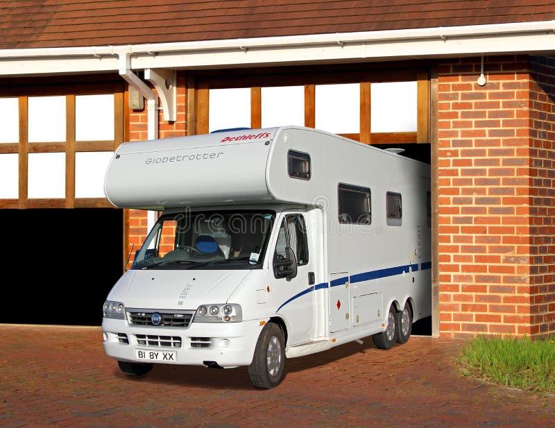 Camper touring van in garage royalty free stock image