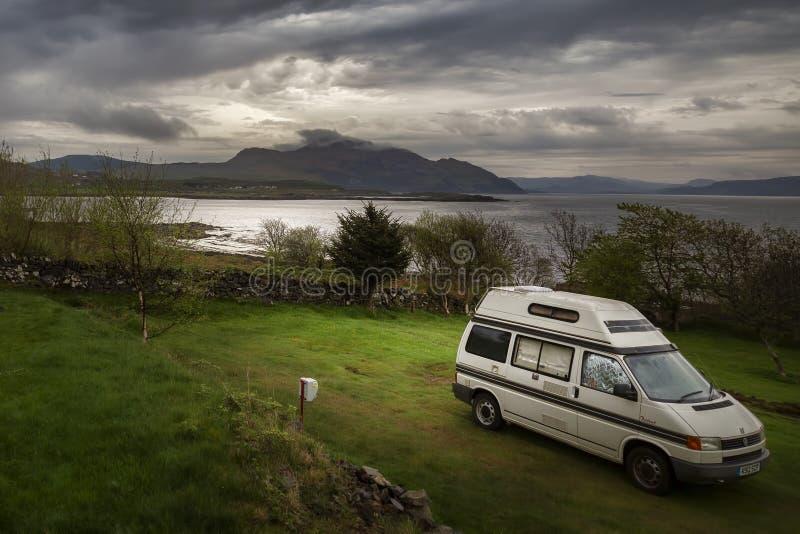 Camper van in grass field near Kilchoan. At dusk stock image