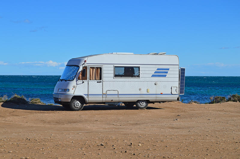 A Camper Van Motorhome On The Beach-Camping Sea View Motor Home stock images