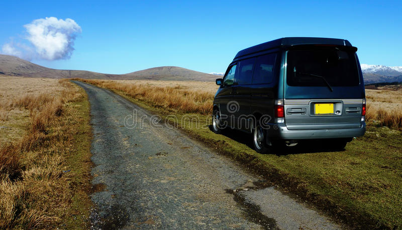 Camper van in wilderness royalty free stock photography