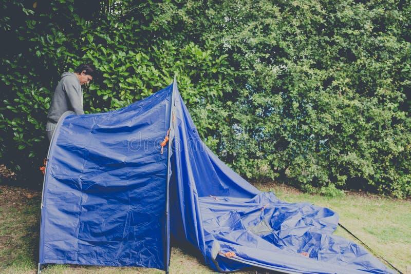 Man pitching tent stock photos
