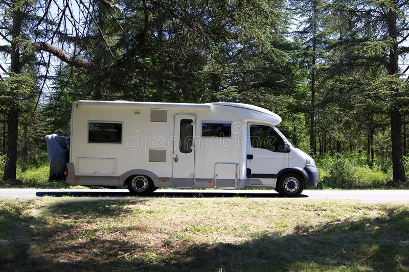 Campervan. On road and forest stock photo