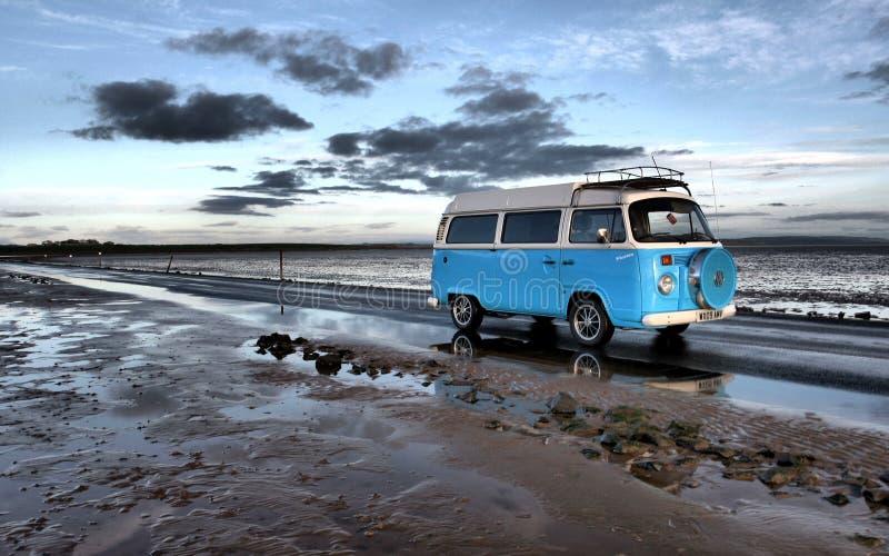 Campervan driving along beach