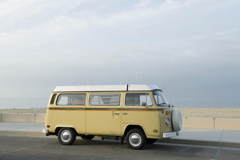 Campervan On Road Along Beach. Side view of a campervan on road along the beach stock photography