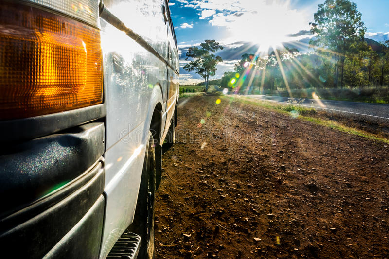 Campervan on the side of australian road with sun rays royalty free stock photos