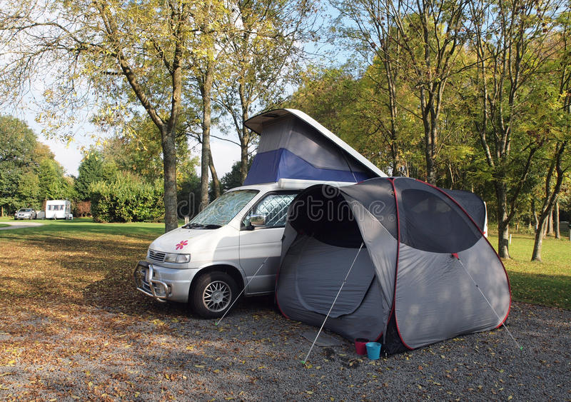 Campervan and tent on campsite stock images