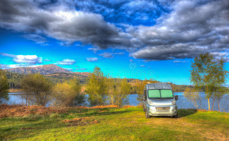 Campervan wildcamping in Scotland by Scottish Loch Garry UK with mountains colourful HDR. Campervan wildcamping in Scotland by Scottish Loch Garry UK with stock images