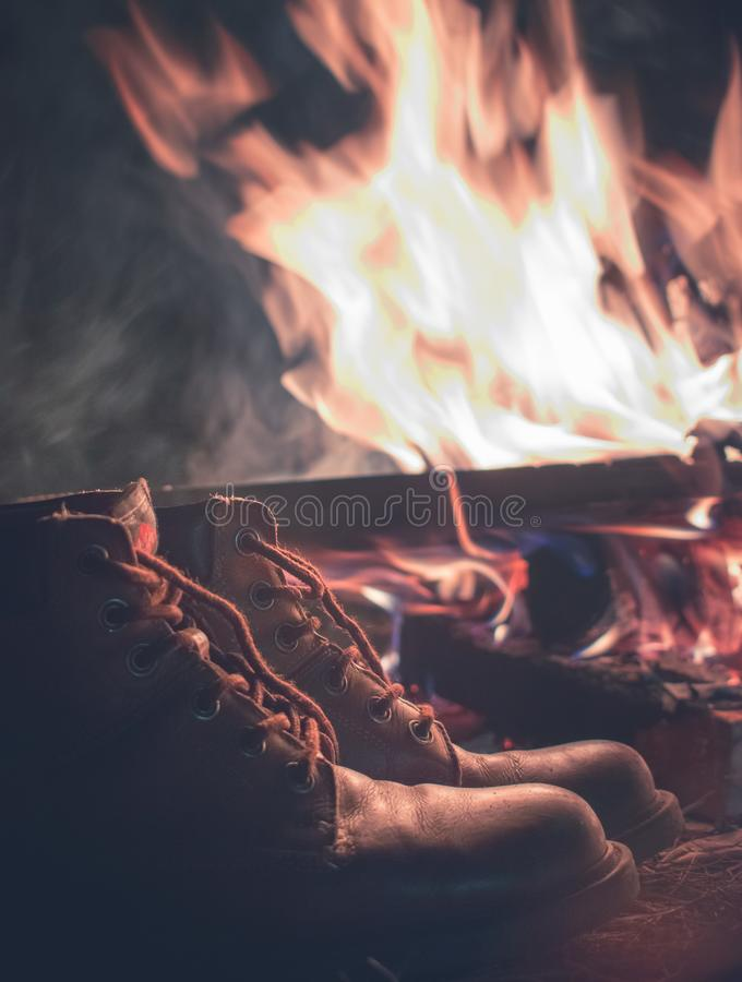 Campfire and biker boots royalty free stock image