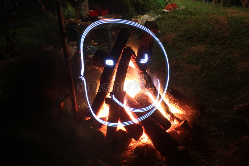 Campfire in fire pit at campsite. stock photography