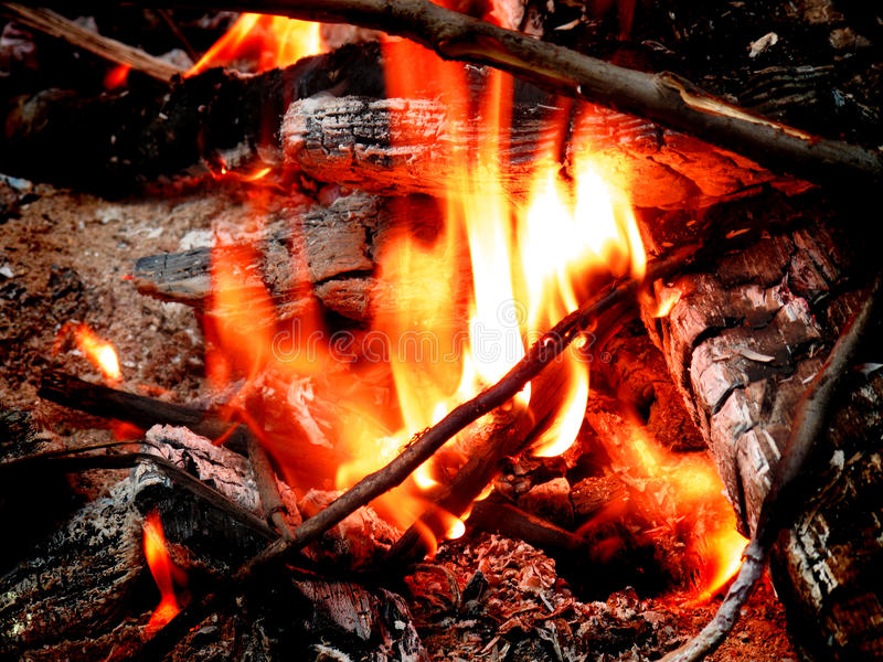 Campfire with Hot Coals. Hot coals and flames in buring campfire royalty free stock photo