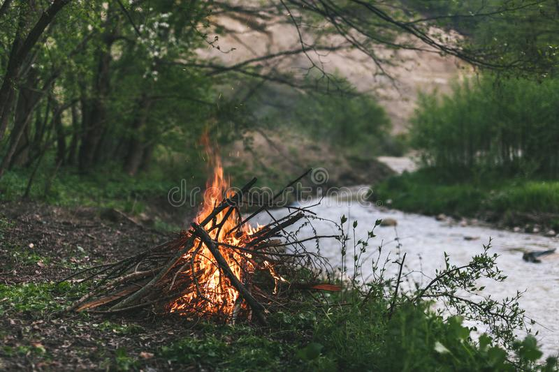 Campfire in nature, near to a river stock photo