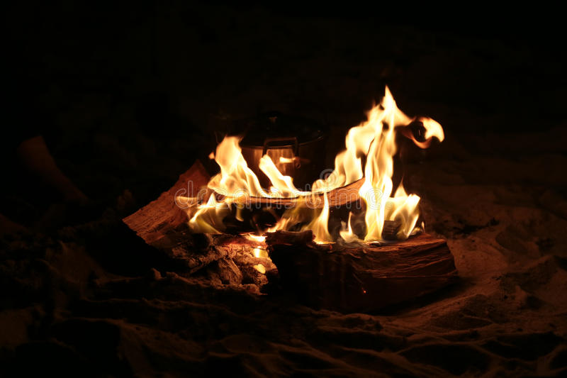 Campfire at night. A beach campfire at night time with wood as fuel stock photo