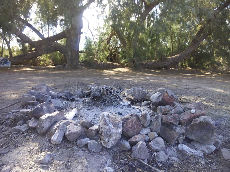 Campfire Pit. A campfire pit is ready for some wood royalty free stock photography