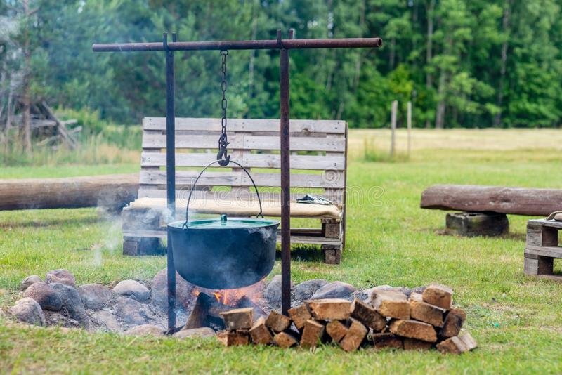 Campfire site with wooden benches near the country house. stock image