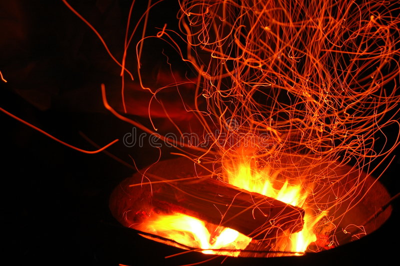 Campfire sparks stock photo