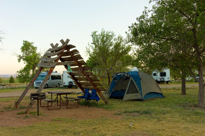 A campground in america. A tent and trailers camping at a facility in texas stock photos