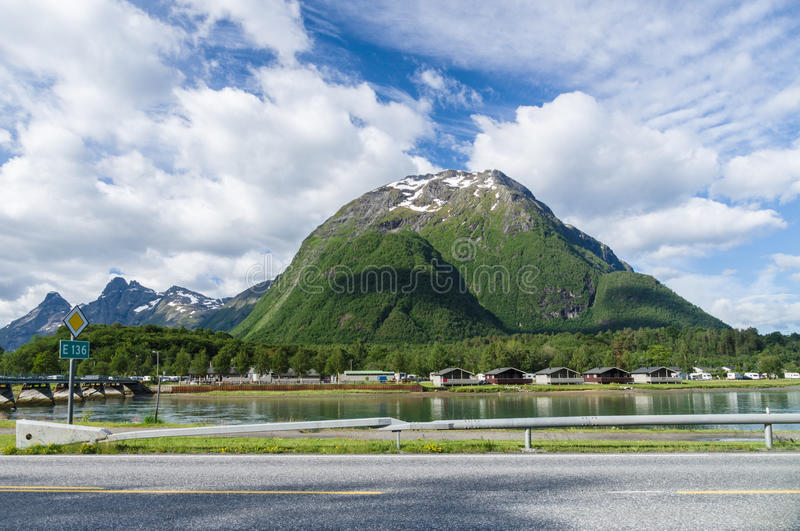 Camping area near river, mountain and road. Summer camping area near river, mountain and road royalty free stock image