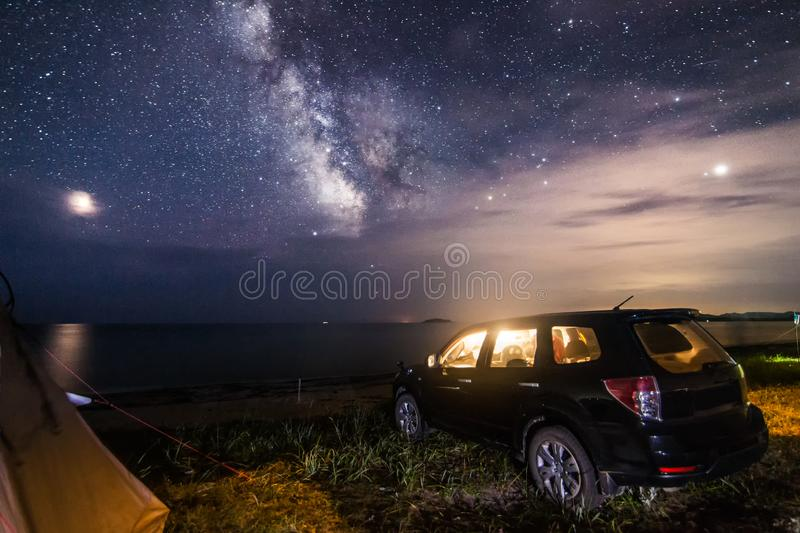 Camping at the beach under night sky stock images