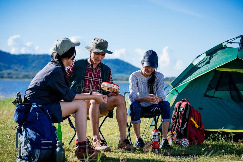 Camping camp in nature happy friends sitting discuss together in stock photography