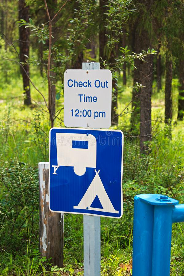 A camping check out time 12:00 pm message sign stock photos