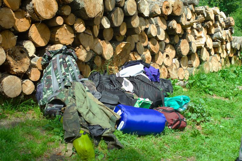 Camping equipment is stacked near the woodpile. Taganay National Park royalty free stock photos